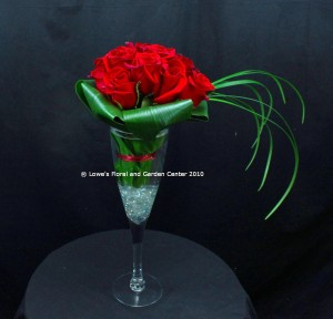 Champagne Tastes: one dozen premium roses arranged in an oversized champagne glass.